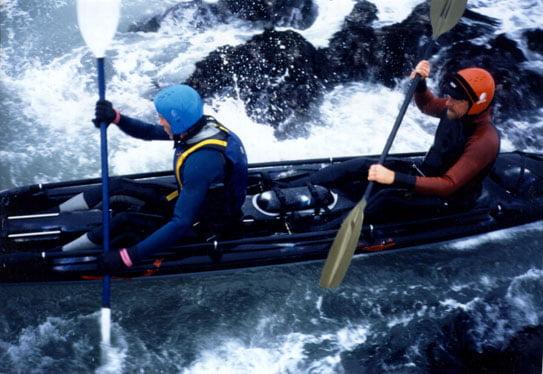 Tsunami Rangers kayaking in a rock garden.