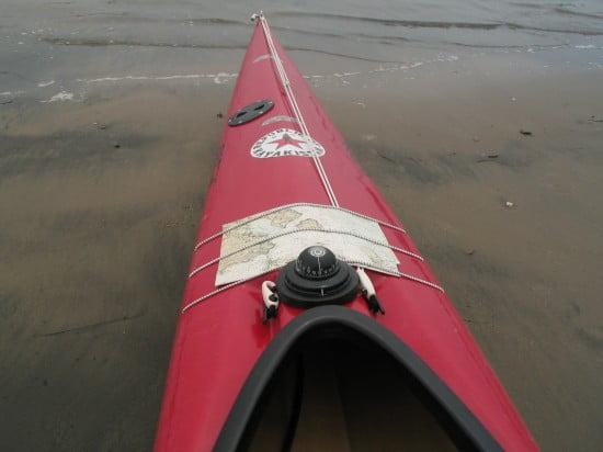 Kayak outfitted with marine compass and chart.