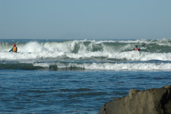 Neil and Tsunami Ranger John Lull (black helmet) punch through incoming waves at the slot.