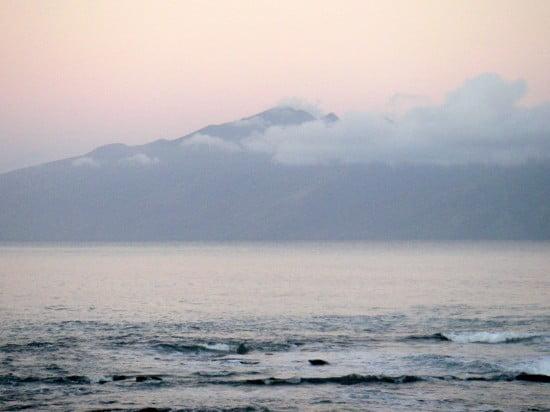 The Hawaiian island of Molokai seen from Napili Bay on the island of Maui