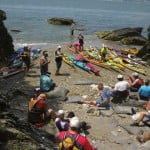 RIKA members have lunch on one of Beavertail's many pocket beaches