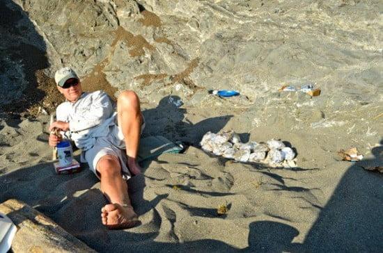 Master wilderness chef TR Scott Becklund keeps and eye on his halibut
