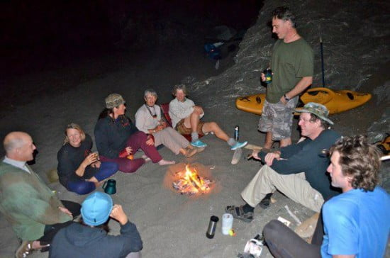 Tsunami Rangers and friends gather round the fire to enjoy cocktails on retreat