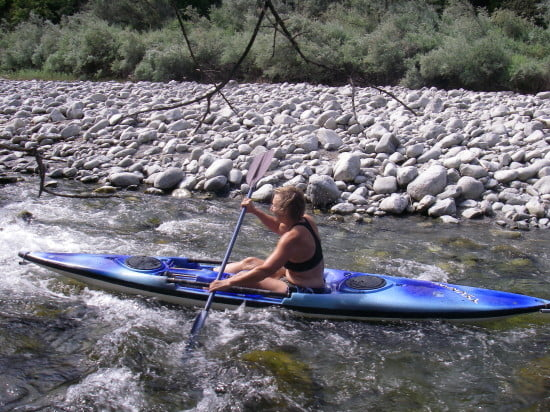 Southern Oregon in July on Carberry Creek, paddling backwards. Current: minimal. Air temp: 90F; water temp: 68F. Water depth: I can walk out and I'm wearing booties. Should I be wearing a helmet and elbow pads too? I thought about it and accepted the risk.