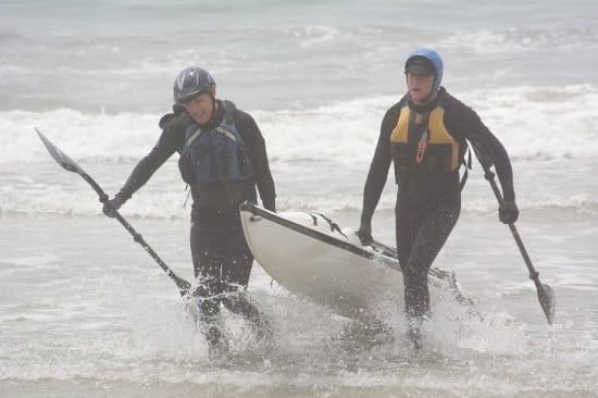 Tsunami Rangers Steve King and Scott Becklund emerge from the surf at the finish