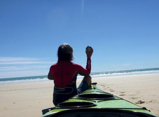 Deb at Tokomaru Bay, NZ, saluting the sea