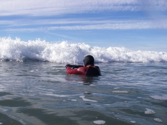 Practicing diving under waves at Crescent City beach. Pictured: Robert Kendall