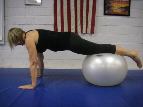 Planking on a stability ball.