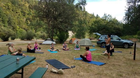 Have yourself an outdoor restorative yoga class at your next kayak camp!