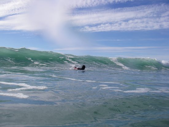 Swimming in the trough of a wave