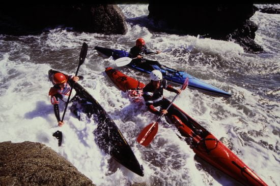 One of Michael Powers' shots for the Extreme Sea Kayaking book: Jim on top, Eric in the middle and Misha