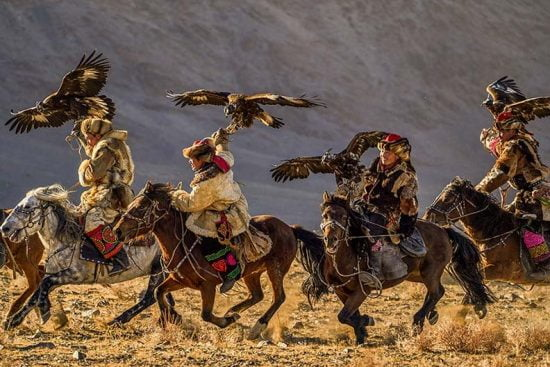 Mongolian riders with eagles