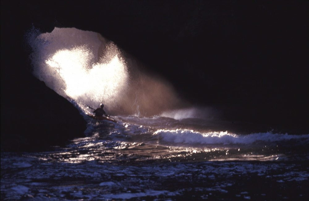 Tsunami Rangers Gordon Brown takes his test in Cathedral Cave on the Oregon Coast, 2000 - photo by Michael Powers