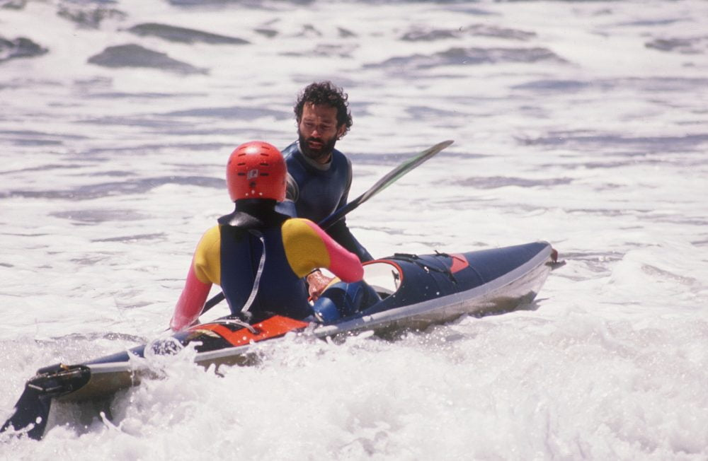 Jim instructing a kayaker in surf