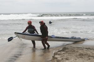 My buddy Denise and I haul the X-3 out of the surf in 2005. 23 out of 32 vessels. Not bad!
