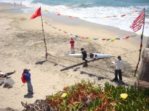 Super racer Kenny Howell crosses the finish line in his surf ski in 2011..