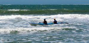 The 2010 winners surfing in