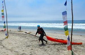 Neptune's Ranger and kayaker extraordinaire Bill Vonnegut crosses the finish line